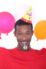 black man at birthday's party