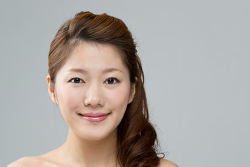 Beautiful asian woman on gray background