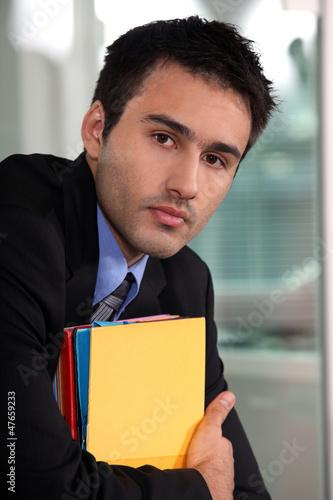 Office worker holding folders