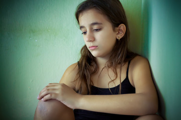 Hispanic girl with a very sad expression
