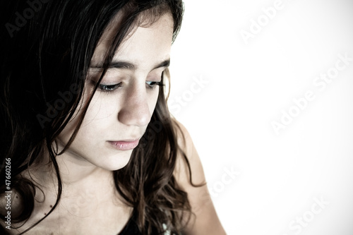 Desaturated portrait of a sad hispanic girl