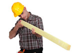 Man holding wooden beam