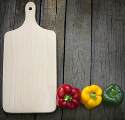 Empty cutting board and paprika abstract background