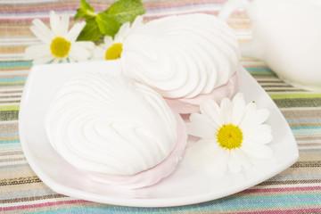 Air marshmallows on a plate, closeup