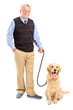 Full length portrait of a smiling senior man posing with his pet