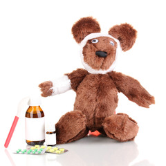 Sick bear wrapped with bandage isolated on white