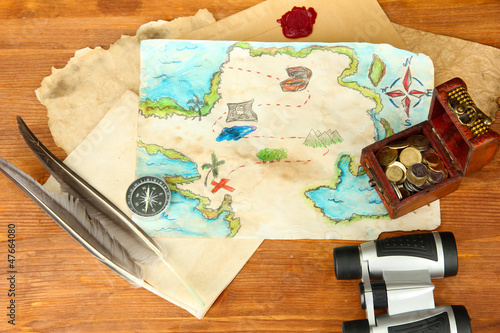 map of treasures on wooden background