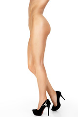 Beautiful female legs in high heels isolated on white background