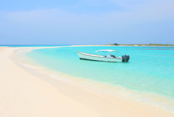 Boat at the tropical beach of Los Roques