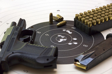 gun and ammunition over bulls eye score