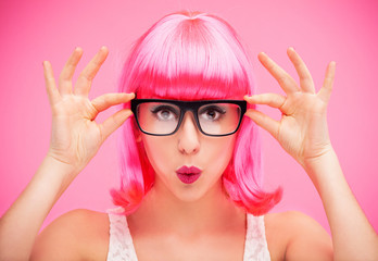 Woman wearing glasses and wig