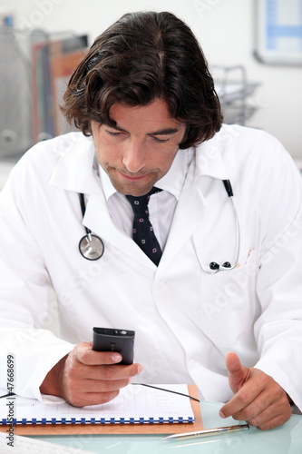 Doctor reading message