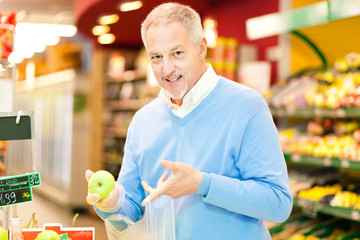 Man shopping at the supermarket