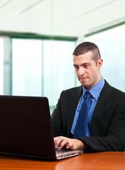 Businessperson using a laptop computer