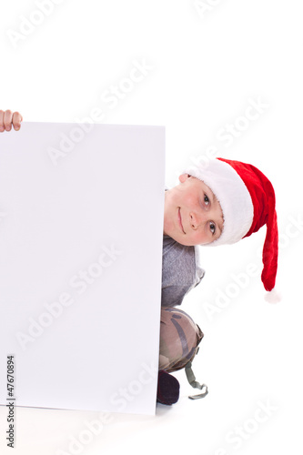 boy in the Christmas hat with a blank