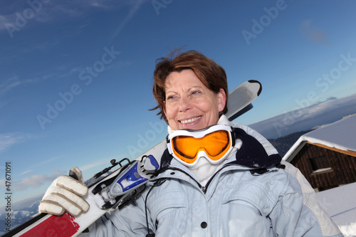 senior woman on a ski vacation