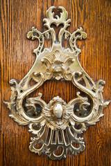 Old wooder door with wetal curl handle