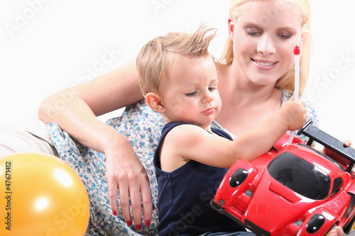 Mum and her son playing with toy car