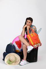 Unhappy woman going away on vacation
