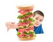 Cute boy enjoying big sandwich isolated on white