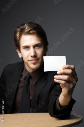 Young man with a business card