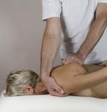 Male therapist treating mature female