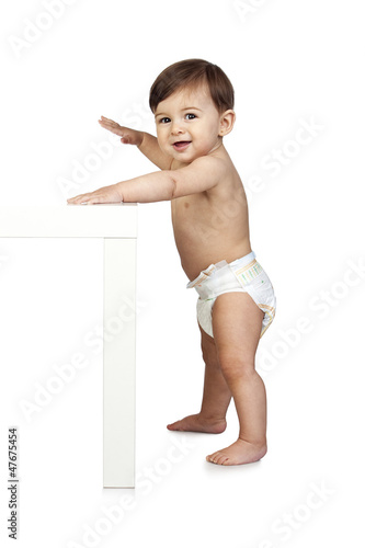 Cute Baby Besides a Table