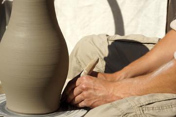 Artisan making clay vase