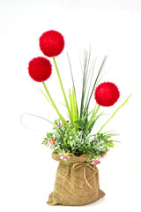 Colorful of Artificial Flower Arrangement on white background