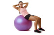 Young woman doing situps on ball
