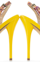 Yellow women stiletto shoes high heels, isolated .