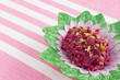 Beetroot and walnuts salad on strapped pink background