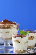 Traditional Italian dessert tiramisu in a glass beaker