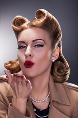 Retro Woman Blowing a Kiss - Old-fashioned Style. Pin Up