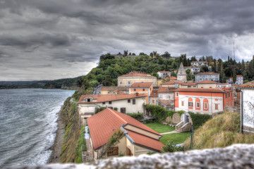 View on the historical city of Piran under a threatening sky, Sl
