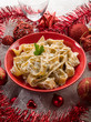 pasta with ricotta and pine nuts on christmas table