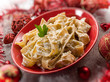 pasta with ricotta and pine nuts on christmas table, selective f