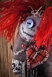 "Handmade Pincushion ""voodoo doll"" on wooden background"