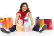 Beautiful woman with present boxes and shopping bags isolated