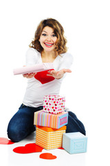 Beautiful woman with present boxes isolated