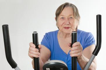 Senior woman on  training bicycle