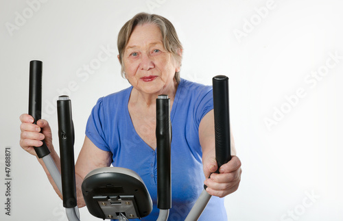 Senior woman on  training bicycle