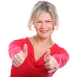 Mid aged beautiful smiling woman showing thumbs up