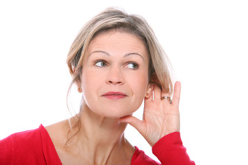 Middle aged blonde in listening gesture