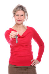 Beautiful mid aged blonde holding a keys