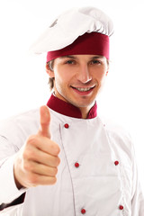 Young and handsome cook showing thumbs up