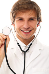 Young and handsome doctor with stroboscope