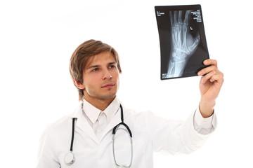 Handsome doktor cheking x-ray
