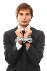 Handsome businessman hands chained