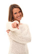 Smiling woman in white sweater pointing at you